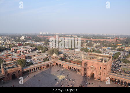 Aerial view of old Delhi and the red fort from a minar of Jama masjid mosque, Delhi (India) - Stock Photo