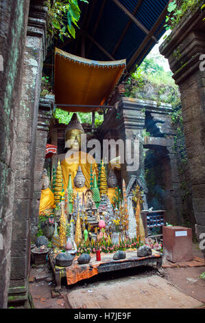 A Buddhist shrine inside Wat Phu, a ruined Khmer Hindu temple complex  in Champasak in southern Laos. - Stock Photo