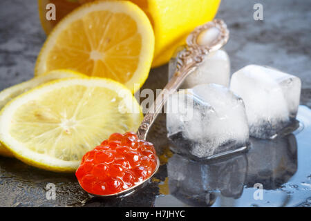 Red salmon caviar and lemon. Selective focus - Stock Photo