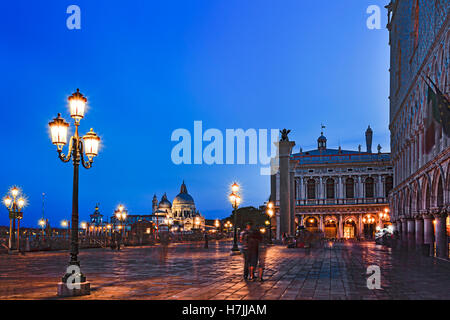San Marco square along grand canal Gondola pier with Venice republic symbols on erected columns towards Santa Maria - Stock Photo