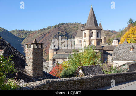The small medieval village of Conques (France). It shows visitors its abbey-church and clustered houses topped by - Stock Photo