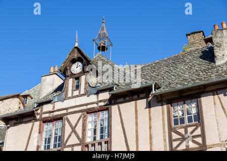 The small medieval village of Conques (Aveyron - France). It shows visitors its old half-timbered houses with their - Stock Photo