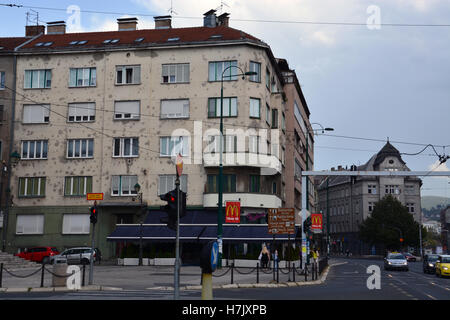 Many buildings in Sarajevo still show the scars of the 1992-96 Serbian siege of the city. - Stock Photo