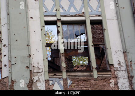 An apartment building in Sarajevo's Old Town remains damaged from the 1992-96 Serbian siege of the city. - Stock Photo