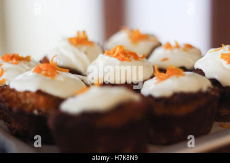 carrot cake muffins with cream cheese and orange zest - Stock Photo