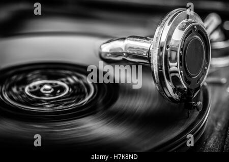 Gramophone playing old disk, old days music, in Black and White, close up shot - Stock Photo