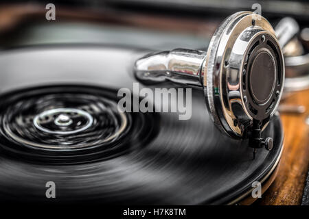 Gramophone playing old disk, old days music,  close up shot - Stock Photo