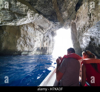 Gozo, Dwejra bay. The Inland Sea. Boat trip to view the Azure Window, passing through through cave access to lagoon. - Stock Photo