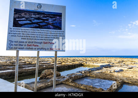 Zwejni saltpans, Gozo, Malta. Roman era saltpans maintained up to the current day actively used. Walking on the - Stock Photo