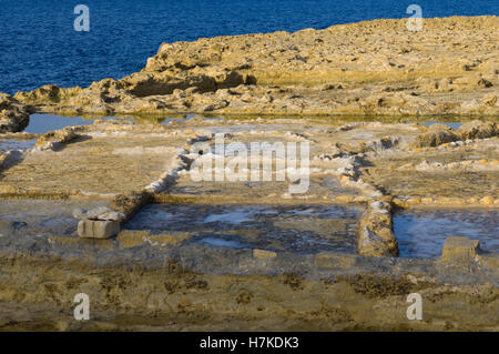 Zwejni saltpans, Gozo, Malta. Roman era saltpans maintained up to the current day actively used. - Stock Photo