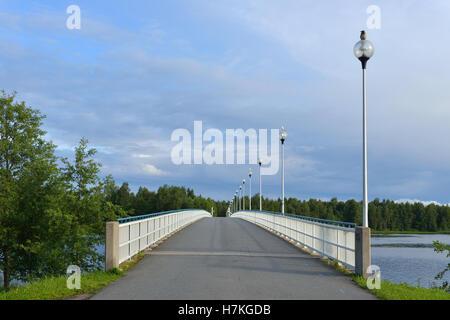 Bridge across river Oulujoki in Oulu, Finland - Stock Photo