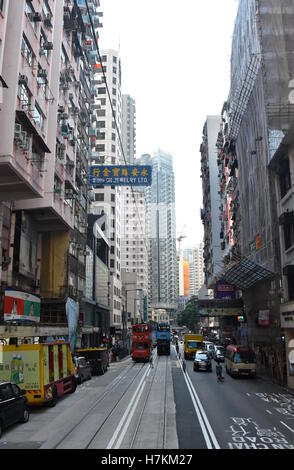 Hong Kong, China - Oct 29, 2016. Road traffic, double tram and Skyscrapers on Hong Kong Island. - Stock Photo