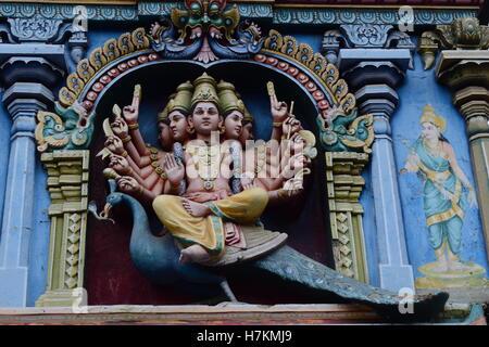 Hindu God Murugan mounted on a peacock Beautiful temple wall Sculpture at Madurai Meenakshi Amman Temple - Stock Photo