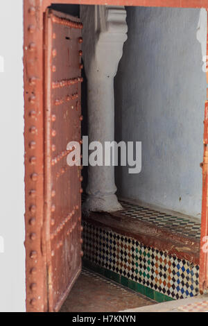 Traditional narrow house entrance for Morocco, colored in white - Stock Photo
