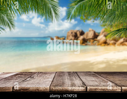 Empty wooden planks with tropical beach on background. Ideal for product placement - Stock Photo