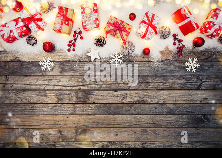 Christmas gift boxes placed on wooden planks. Copyspace for text - Stock Photo
