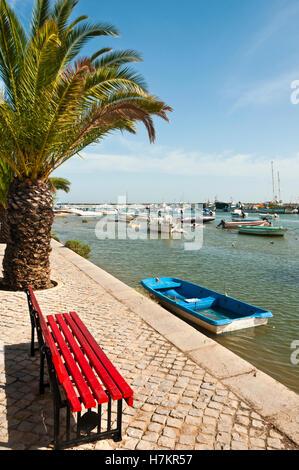 Seafront and boats, Santa Luzia, Algarve, Portugal - Stock Photo