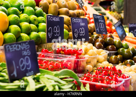 Fruits and vegetables on the market, with a price tag - Stock Photo
