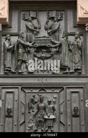 Close-up of the bronze main portal of St. Vitus Cathedral in Prague, Czech Republic - Stock Photo