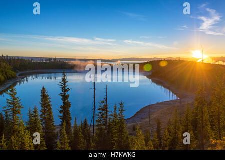 Sunrise over Yellowstone Lake in Yellowstone National Park in Wyoming - Stock Photo