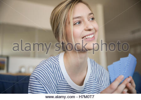 Close up young woman playing cards - Stock Photo