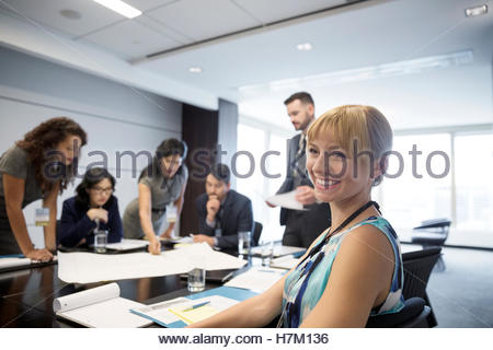 Portrait smiling female architect in conference room meeting - Stock Photo