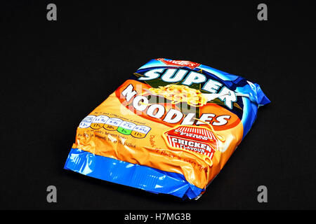 Batchelors fried chicken flavour super noodles isolated on a black background - Stock Photo