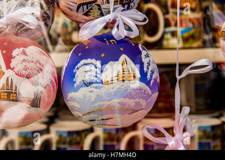 Christmas toy. Christmas tree toy blue glass ball with a picture of the house in the snow. Christmas theme. - Stock Photo
