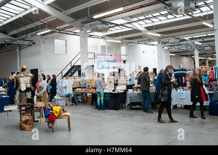 People at the Renegade Craft Fair, an indoor indie market event held at the Old Truman Brewery in Shoreditch, East - Stock Photo