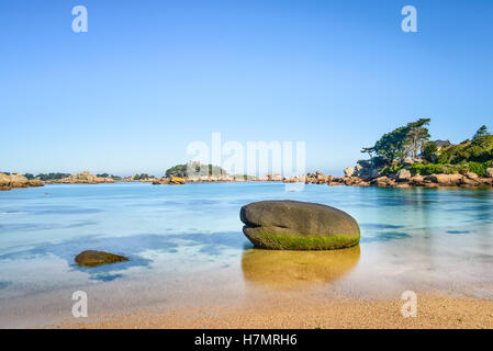 Ploumanach, ock and bay beach in morning. Toned. Pink granite coast, Perros Guirec, Brittany, France. Long exposure. - Stock Photo
