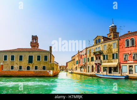 Murano glass making island, water canal, bridge, boat and traditional buildings. Venice or Venezia, Italy, Europe. - Stock Photo