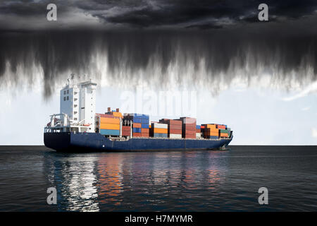 Sea landscape with container ship and rain over ocean. - Stock Photo