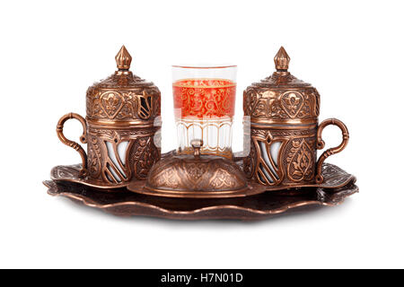 Set of traditional Turkish coffee with sugar bowl and water glass, isolated on white background. - Stock Photo