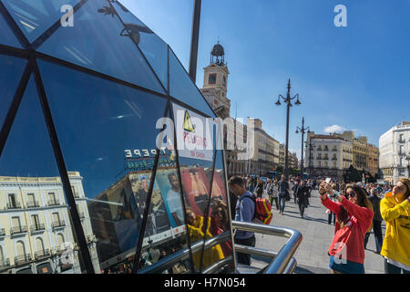 the Puerta del Sol reflected in the glass cover of Sol Metro station,  Madrid, Spain. - Stock Photo