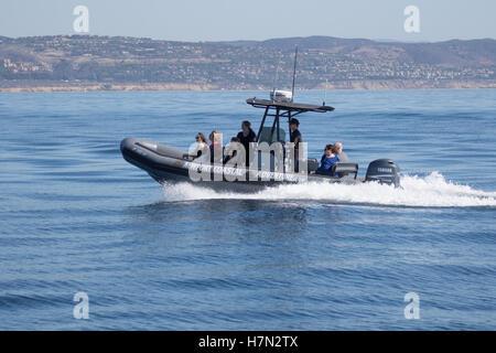 Newport Coastal Adventure Zodiac boat on a whale watching trip of the coast of Orange County  Southern California - Stock Photo