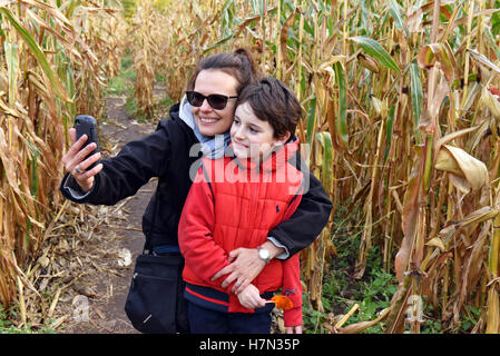 Mother and child taking sellfie with mobile phone - Stock Photo