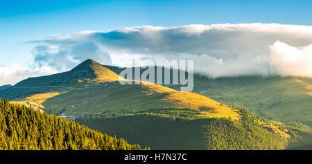 Papusa peak and Ranca resort ski slopes on a summer day sunrise, in Parang mountains, Romania - Stock Photo