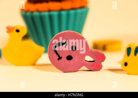 various shaped pencil erasers, bunnys, duck, cupcake - Stock Photo