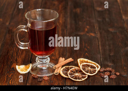 Compote or tea with fruit ingridients, dried orange, cinnamon, raisin - Stock Photo