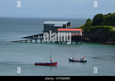 Old and new lifeboat stations at Tenby, Pembrokeshire, Wales - Stock Photo