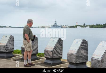 Honolulu, Hawaii Pearl Harbor Memorial USS Arizona man looking at plaques war dead Japan bombing - Stock Photo