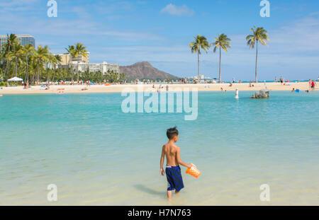 Honolulu Hawaii Oahu Hilton Hawaiian Waikiki Beach  Diamond Head in distance with beach and ocean - Stock Photo