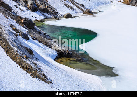 Colorful Emerald Lakes in the winter Tongariro Alpine Crossing, New Zealand - Stock Photo