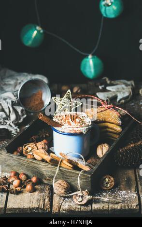 Mug of hot chocolate, garland with blue balls at background - Stock Photo