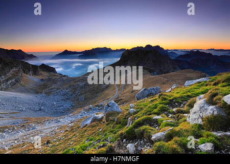 Mountains sunset landscape. Julian alps in Europe. Slovenia and Italy in a distance. - Stock Photo