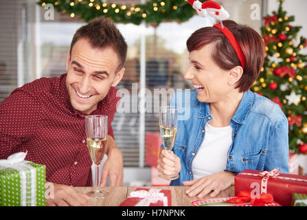 Couple had some laughs and sitting near the table - Stock Photo