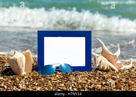 Summer vacation composition. Picture frame, hat and other stuff ...
