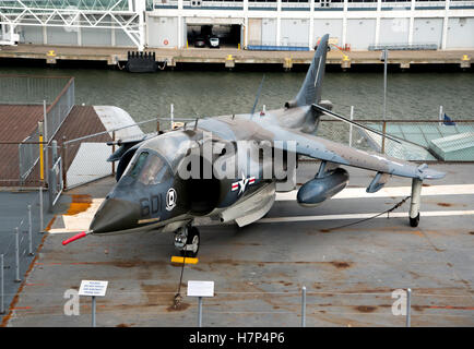 Harrier jump jet on the deck of USS Intrepid Museum of Air and Space - Stock Photo