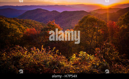 Great Smoky Mountain Sunset. Sunset from a Blue Ridge Parkway overlook with the Great Smoky Mountains at the horizon. - Stock Photo