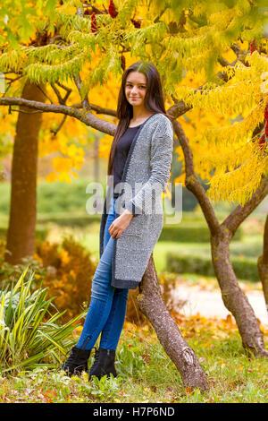 portrait of pretty teen girl in autumn park. Smiling happy girl portrait, autumn outdoor. - Stock Photo